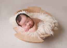 newborn baby in trencher bowl