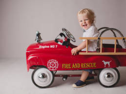 one year old boy drives fire truck